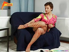 She fools around solo in her pretty pantyhose tubes