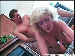 Mature wears lingerie as young guy fucks her tubes
