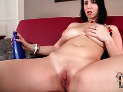 She rubs lotion into her shaved pussy and big tits tubes