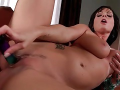 Shiny toy slides into her hot wet pussy tubes