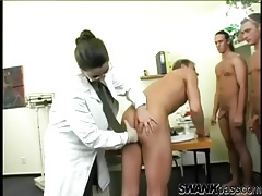 Nurse with big tits sucks on three dicks tubes