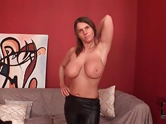 Busty chick shows off her tight leather pants tubes