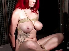 Redhead with big bound tits is sexy tubes
