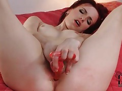 Toy in her booty has the redhead moaning tubes