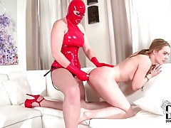 Latex mistress fucks her ass with strapon tubes