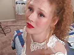 Redhead in wedding dress models her pussy tubes
