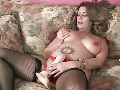 Chubby mom in lingerie has fun with toy tubes