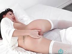 Chick in white fishnets toy fucks pussy tubes