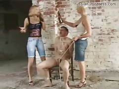 Dude is tied up and beaten on by two girls tubes