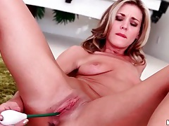 Pretty girl with small titties plays with her pussy tubes