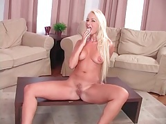Blonde with long legs rubs her pretty pussy tubes
