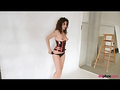 Latex corset on girl with curly red hair tubes