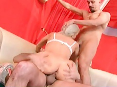 Sweet blonde in high heels sucks and fucks two dicks tubes