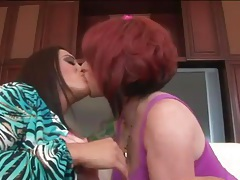 Tattooed redheaded mom in lesbian sex video tubes