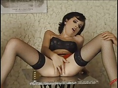 Pretty girl in black fishnets does a DP tubes