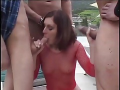Beautiful girl in fishnet top fucked in a gangbang tubes