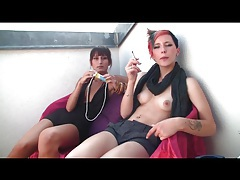 Punk chick with tits out smokes a cigarette tubes