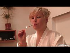 Curvy girl in white satin robe smokes tubes