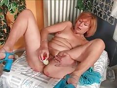 Curvy mature masturbates with her dildo tubes