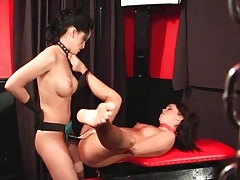 Strapon cock fucks sub girl over a table tubes