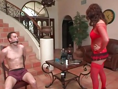 Tied and gagged guy teased by Eva Angelina tubes
