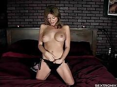 Pornstar Lisa Daniels teases her big fake tits tubes