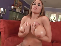 Curvy girl oils up her tits for a titjob tubes