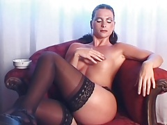 Smoker in slutty makeup masturbates and fondles tubes