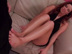 She teases with her feet and sucks his dick tubes