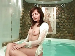 Redhead in the pool has a tiny set of tits tubes