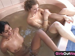 Girls out west - cute lesbians in a whirlpool tub tubes