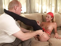 She lets the old guy suck on her toes tubes