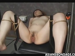 Japanese slave gets pussy filled by cum tubes