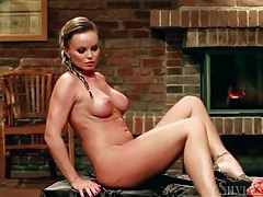 Stripping and teasing chick in front of fireplace tubes