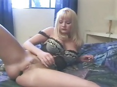 Solo milf in sexy lingerie masturbates her pussy tubes