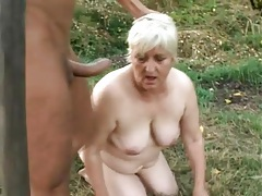 Masked man fucks naughty slut in the grass tubes