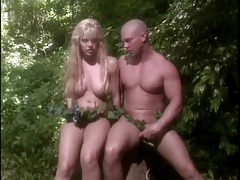 Finger banging a fake titty blonde chick in jungle tubes