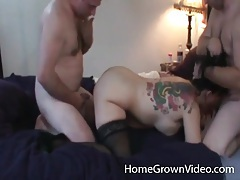 Tattooed girl in stockings sucks and fucks with two guys tubes