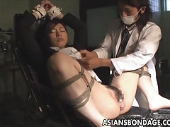 Asian bondage babe tied up with pussy spread wide tubes