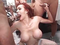 Redhead mom with big tits sucks cocks in blowbang tubes