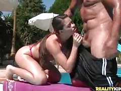 Chick in slutty bikini sucks a hard dick outdoors tubes