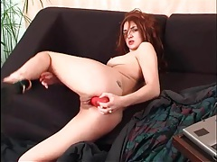 Cute redhead on cam fucks her pussy with a toy tubes