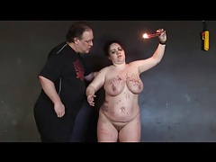 Fat girl likes the hot wax hitting her sexy body tubes