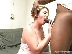 Fatty gives good head to a big black cock tubes