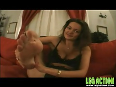 Big boobs brunette gal shows off her sexy feet tubes