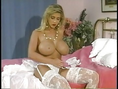 80s pornstar with huge tits rubs lotion into her skin tubes