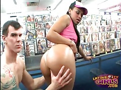 Latina gives big dick blowjob in porn video store tubes