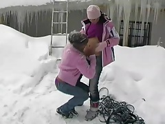 Lesbian snow bunnies in sweaters outdoors tubes