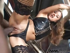 Interracial sex on a catwalk with a slut in leather tubes