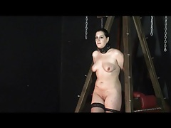 Chubby girl in collar and boots is bound tubes